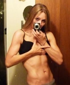 Gina Matthews black bikini ab shot