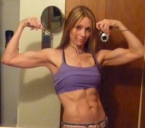 gina matthews in purple top double bicep and ab shot